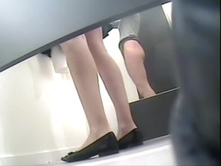 Legs in flat shoes on the fitting room voyeur camera