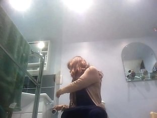 Sexy milf looking around when pissing on the toilet