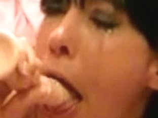 sex-toy deepthroat brunette hair gagging to please