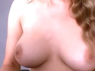 Curly-haired babe doesn't hide her big melons from people