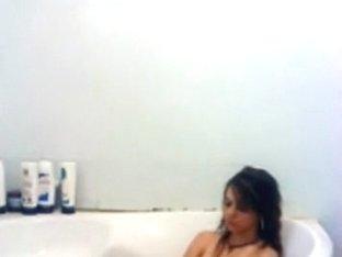 girl masturbates with the showerhead in the bathtub