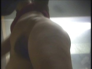 A spy cam in the sports club changing room takes the view of a milf's thighs and pussy