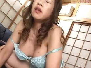Busty Asian milf blowing and riding her man's belly stick