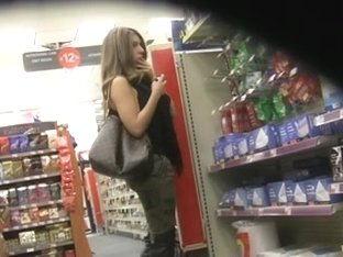 Babe with nice ass candy shopping