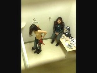 Cute Latina strips before a spy cam in the changing room