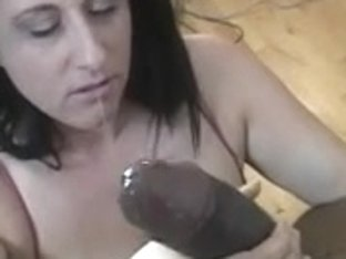 Dark Brown with large zeppelins sucks on a giant darksome shlong on her knees