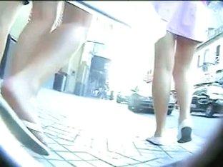 Three teens on the street followed by an upskirt cam