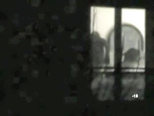 Voyeur thru window black-and-white neighbor video