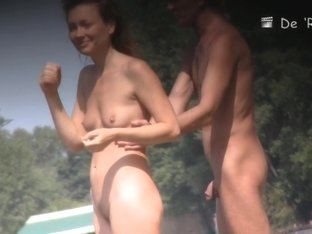 Naked beauty is dreaming on beach on the voyeur camera