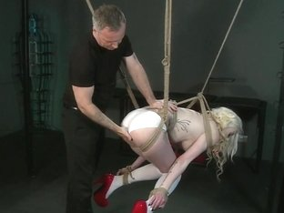Sexy blonde gets hooded and suspended as both holes are filled my Master