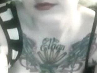 tattooed busty blonde plays with pussy