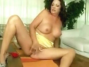 Sizzling brunette milf masturbates on a table in homemade solo