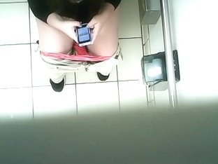 Spy camera installed in public toilet ceiling