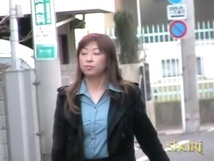 Street sharking scene of some really pretty brown-haired beauty