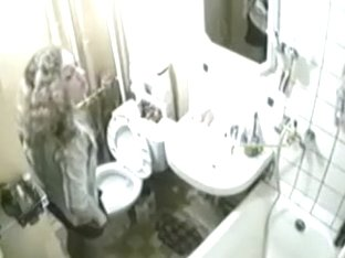 Sweet girl spied on camera while sitting on toilet