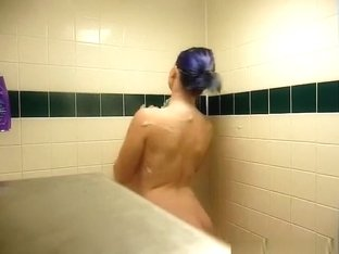 Hot emo girl with purple hair plays with her big tits in the shower