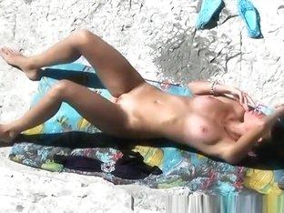 Tight body nudist sunbathing and smoking