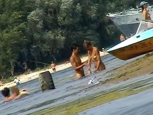 Russian peach talking with her boyfriend on the beach