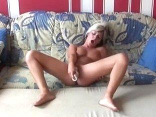 Jil masturbates with a sex toy hard