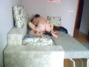 Teen couple fucking in couch