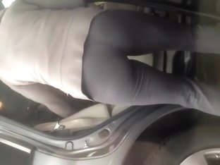 Hot milf filmed while cleaning her car