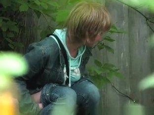 Short hair blonde caught peeing outdoors