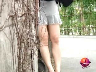 Cat goes near the legs of a babe who gets wet sharking video