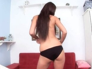 Kitty demonstrates her shaved pussy and spreads it