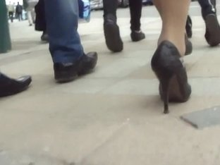 Ladylike woman demonstrates nice legs under dress with cutout