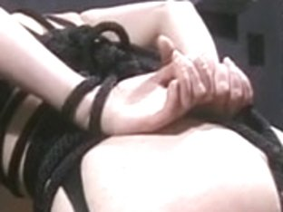 Hawt babe in mask and rubber acquires tortured