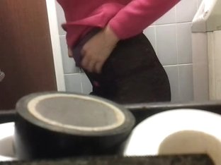 Slim chick bares her ass in front of a toilet camera