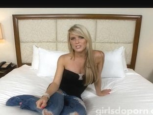 Blonde exposing her assets for a large dildo to take