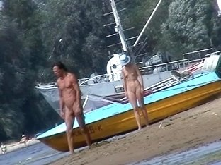 Nudist babes walk on the beach with no worries