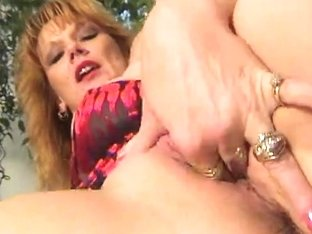 Aged redhead fingers herself