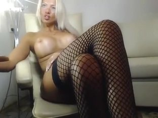 LadyLuscious: a naked blonde sitting in a chair