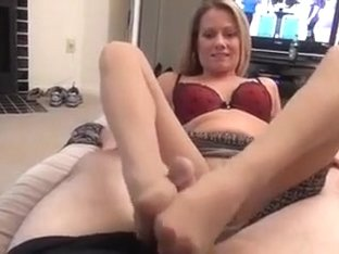 Mature woman uses her feet on a cock.