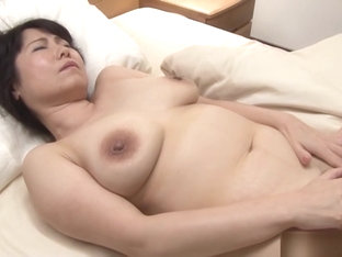 Mature and horny Japanese AV model is caught masturbating