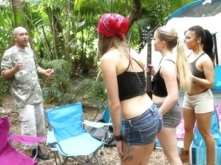 Lucky stud has a gang of lustful camping girls sharing his stiff pole