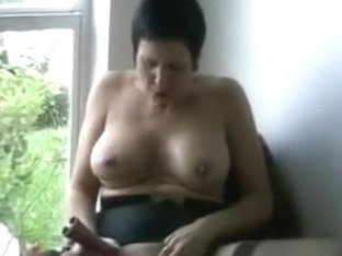 She masturbate in front of the window