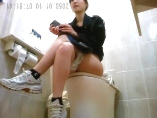 Asian women spied in toilet taking a pee