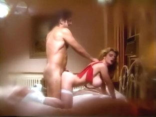 Voluptuous blonde cougar Belle fully enjoys a hard pounding on the bed