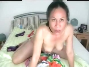 Mature Filipina sitting on her vibrator
