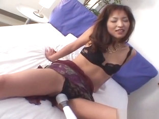 Sexy Oriental woman in pantyhose has her pussy teased with sex toys