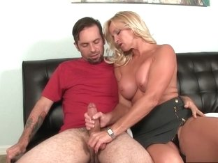 Lucky boy gets his big shaft jerked off by his girlfriend's busty mom