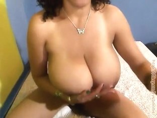 Playful aroused brunette does titjob with huge boobs