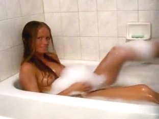Great looking brunette hottie masturbates in bathtub