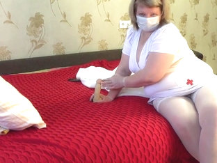 Mature plump nurse treats sexual arousal, therapy on the example of a rubber dick and cream pie.