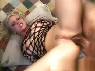 Trashy blonde happily welcomes a long black stick up her narrow ass