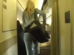 Hot blonde in tight jeans pants seat in airplane