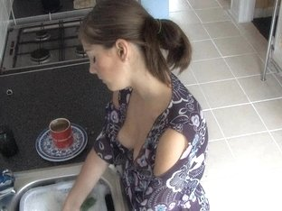 Beauty exposed in down blouse video while doing the dishes